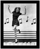 Rita Hayworth Music Notes Background in a Dancing Pose High Quality Photo