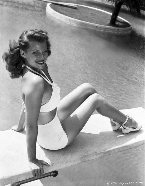 Rita Hayworth Seated on the Pool Side Premium Art Print