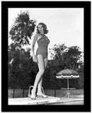 Rita Hayworth standing on a Diving Board in Swimming Suit High Quality Photo