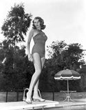 Rita Hayworth standing on a Diving Board in Swimming Suit Premium Art Print