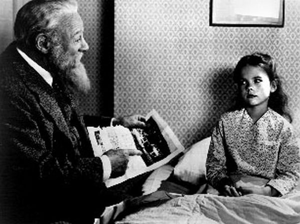 Miracle On 34th Street Movie Scene with an Old Man Reading a Paper to a Girl Premium Art Print
