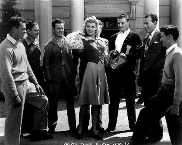 Blondie Goes To College A Girl Surrounded by Men in Black and White Premium Art Print