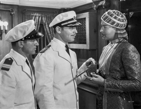 Jean Harlow Scene from a Film Two Men in White Uniform and Peak Cap Talking to a Man Holding a Pistol Premium Art Print