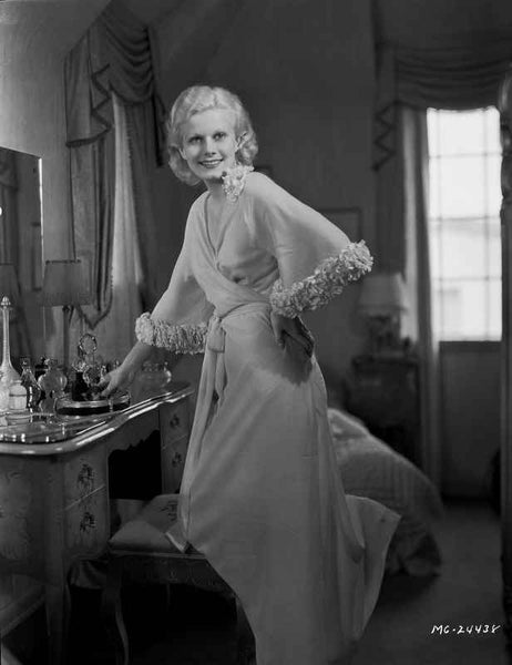 Jean Harlow Posed In front of a Dresser in Folded Top Silk Dress Premium Art Print