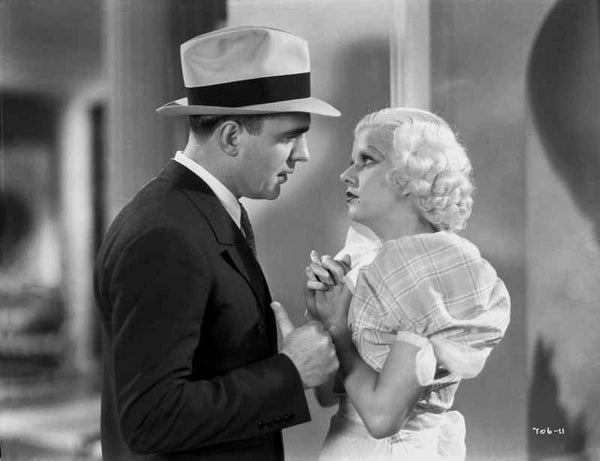 Jean Harlow Scene from a Film standing In front of a Man in White Tartan Mutton Short Sleeve Dress with Hands Together and Fingers Crossed Premium Art Print