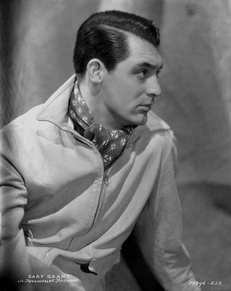 Cary Grant in a coat and scarf with a part in his hair  Premium Art Print...