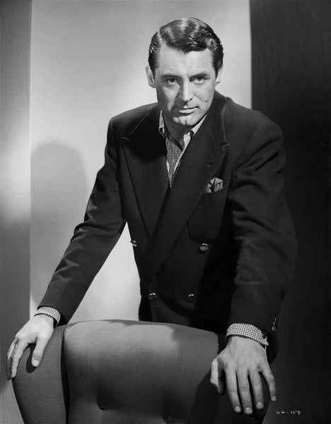 Cary Grant standing Behind Chair In Suit Premium Art Print