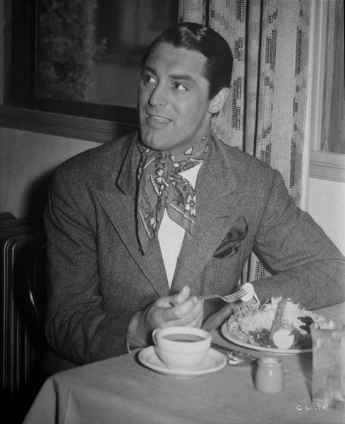 Cary Grant eating in a scarf and jacket Premium Art Print