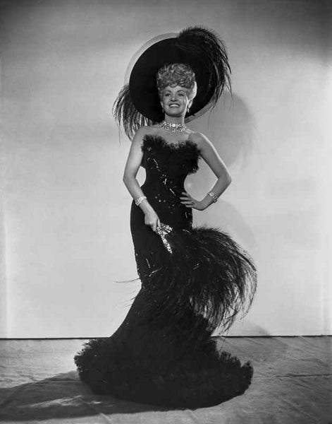 Betty Grable Posed with Hand on the Waist in Black Feathered Broad Round Hat and Black Strapless Fur Top Silk Dress Premium Art Print