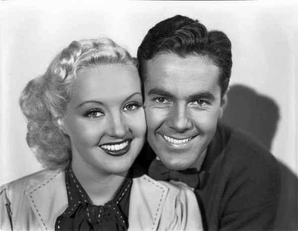 Betty Grable Couple Shot Portrait smiling with Partner in White Suit Dress and Black scarf Premium Art Print