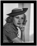 Betty Grable Portrait with Chin Leaning on Hand in Velvet Hat and Polka Dot Short Sleeve Dress High Quality Photo