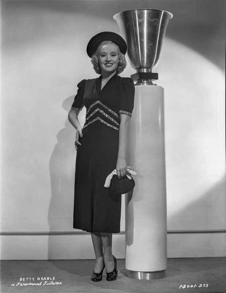 Betty Grable Posed Hand on the Waist in Short Sleeve Linen Dress and Black Round Hat Premium Art Print
