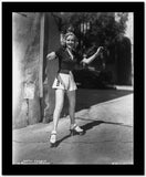 Betty Grable Posed with Arms Raised Up with Legs Spread in Black Short Sleeve Collar Shirt and White Skirt High Quality Photo