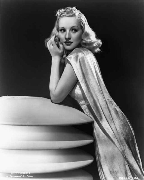 Betty Grable Posed Leaning on a Round Flat Figure in White Silk Strap Dress with Silk Long Scarf Premium Art Print