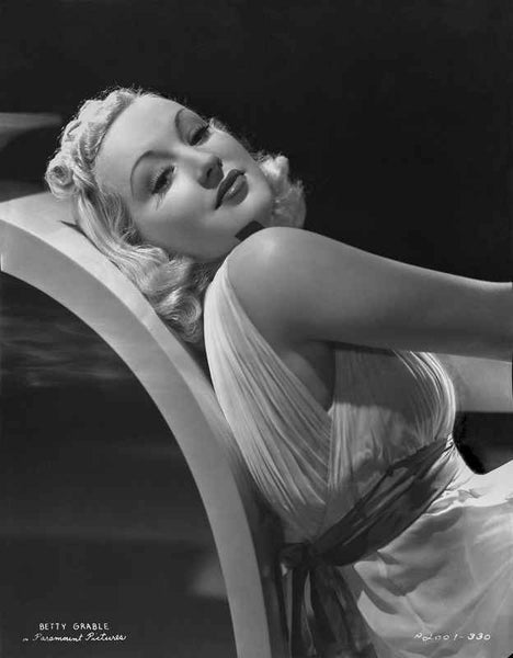 Betty Grable Lying on the Chair in White Silk Belted Dress with Curly Hair Premium Art Print