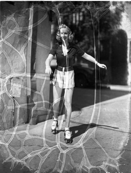 Betty Grable Posed with Arms Raised to the side in Black Short Sleeve Collar Shirt and White Short Skirt with White Skate Shoes Premium Art Print