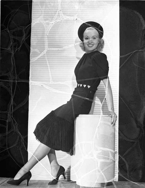 Betty Grable Reclining on a White Box in Black Hat and Short Sleeve Silk Dress with Black High Heel Shoes Premium Art Print