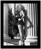 Betty Grable Posed standing Beside a Concrete Roman Column in Black Backless Strap Dress with Short Skirt High Quality Photo