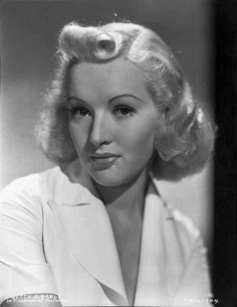 Betty Grable Portrait in White Collar Short Sleeve Shirt with Curled Up Hair Premium Art Print