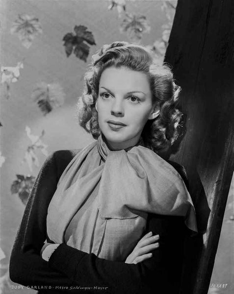 Judy Garland arms folded with scarf and leaves behind her  Premium Art Print...