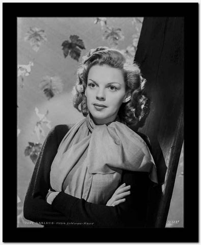 Judy Garland arms folded with scarf and leaves behind her High Quality Photo...