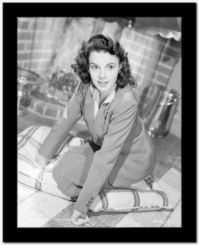 Judy Garland kneeling on cushion High Quality Photo