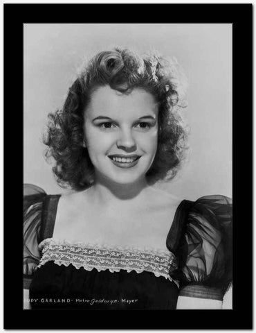 Judy Garland wearing a Cap-Sleeve Dress in a Portrait High Quality Photo