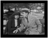 Greta Garbo with a Man wearing Formal Outfit with Hat High Quality Photo