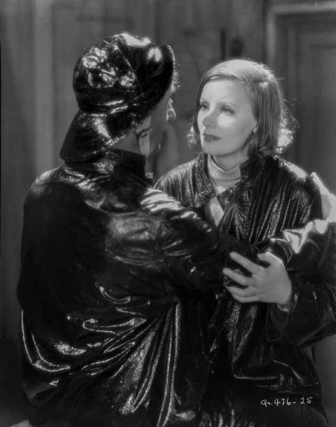 Greta Garbo and a Man wearing Shiny Black Outfit Premium Art Print