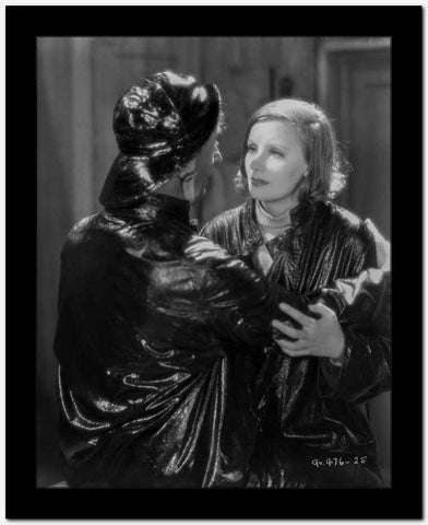 Greta Garbo and a Man wearing Shiny Black Outfit High Quality Photo