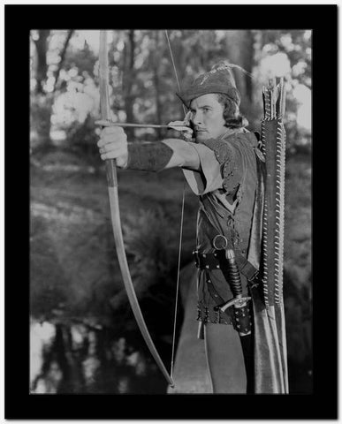 Errol Flynn Firing Arrow in Robin Hood Attire High Quality Photo