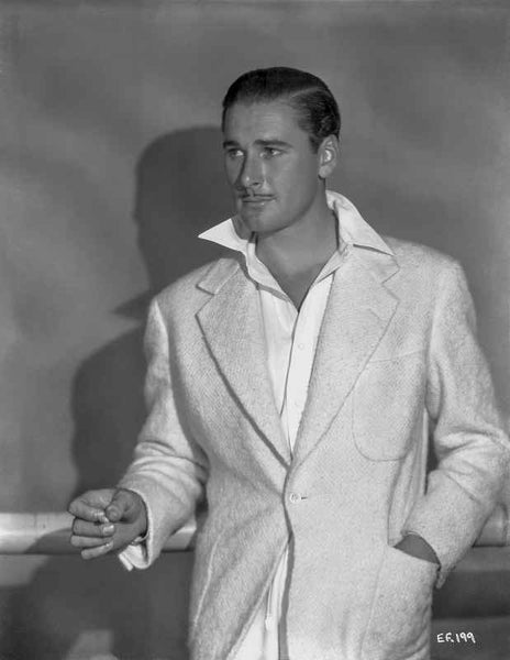 Errol Flynn wearing a White Suit in a Daring Pose Premium Art Print