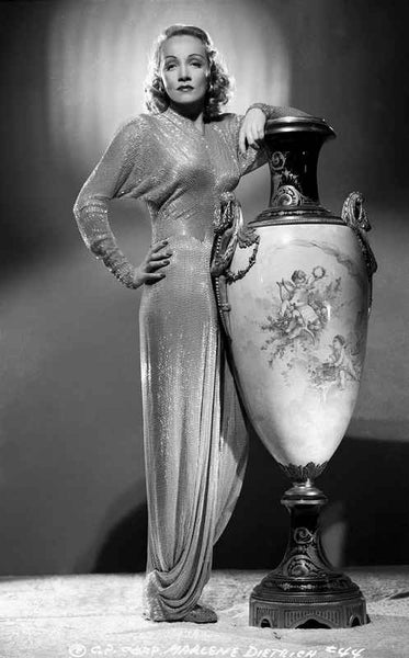 Marlene Dietrich standing in Classic Gown with Jar Premium Art Print