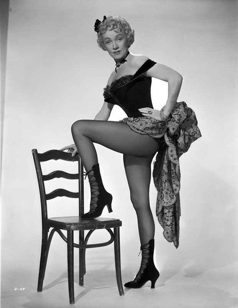 Marlene Dietrich standing One Leg in Black Lingerie with One Leg Stepping on Chair Premium Art Print