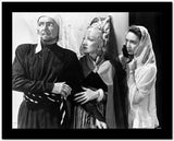 Marlene Dietrich with Two People Looking Away in Movie Scene High Quality Photo