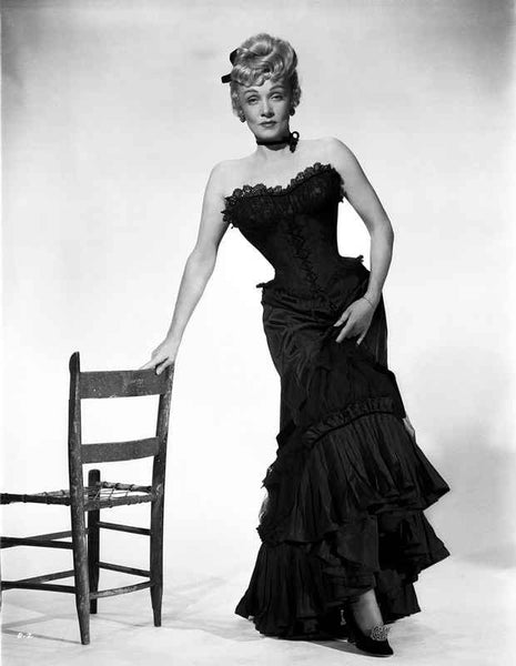 Marlene Dietrich standing in Strapless Black Dress with Chair Premium Art Print