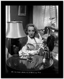 Marlene Dietrich sitting in White Long Sleeve High Quality Photo