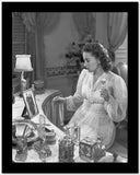 Olivia DeHavilland Seated in Silk Dress High Quality Photo