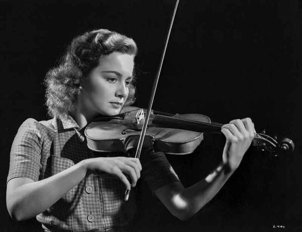 Olivia DeHavilland Playing Violin in Plaid Dress Premium Art Print
