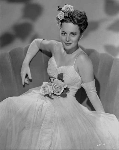 Olivia DeHavilland Seated in Spaghetti Top Gown Premium Art Print