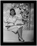 Olivia DeHavilland Seated in Classic with Heels High Quality Photo