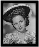 Olivia DeHavilland Portrait in Floral Dress with Hat High Quality Photo