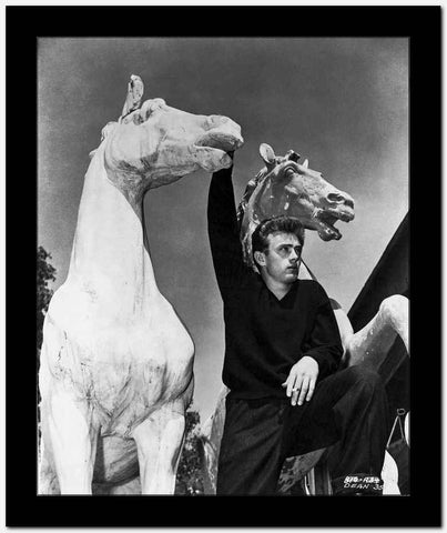 James Dean Posed in Black Long Sleeve V-Neck Shirt with Right Hand Holding on a White Horse Figure High Quality Photo