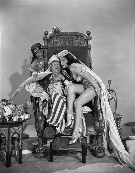 Dead End Kids Cast Member in a Royal Chair with a Girl and a Guy at Back of The Chair Premium Art Print