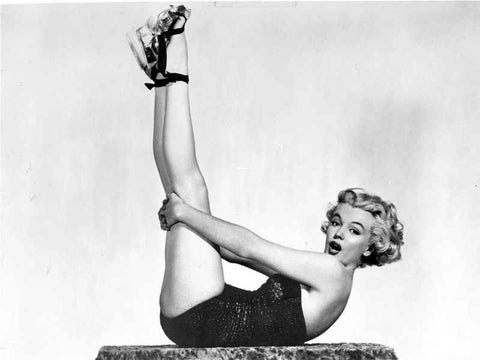 Marilyn Monroe in a Black Bathing suit, her Legs Straight Up in the Air High Quality Photo