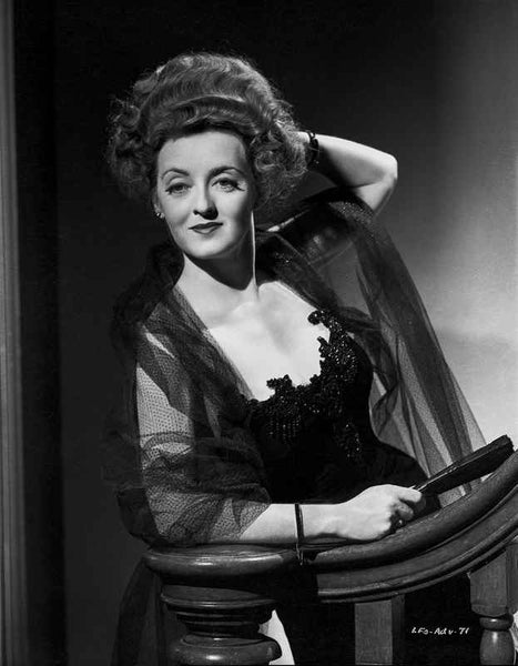 Bette Davis Posed on the Staircase with Hand on the Head in Black Velvet Dress and Black Sheer Linen Coat Premium Art Print