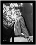 Bette Davis Reclining on a White Box in Embroidered Suit and Black Dress High Quality Photo