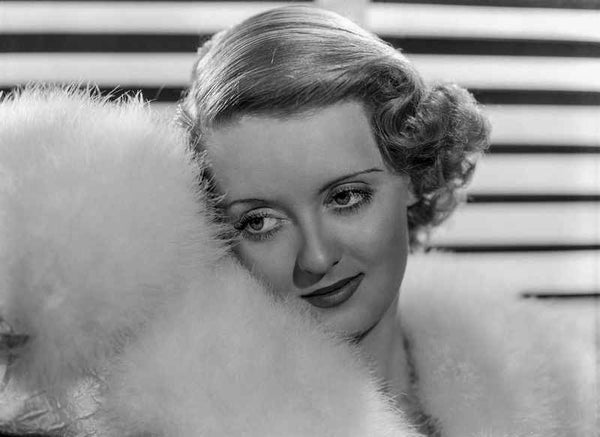 Bette Davis Portrait with Leaning to the Right in White Fur Boa and White Fur Pelted Dress Premium Art Print