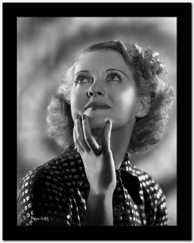 Bette Davis Portrait Hand on the Chin Looking Up in Polka Dot Black Dress with Short Curls High Quality Photo
