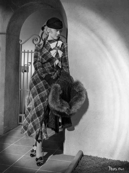 Bette Davis Leaning on the Corner Holding a Black Fur Boa in Black Hat and Tartan Long Sleeve Dress Premium Art Print